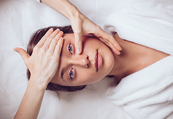 Woman laying down before a cosmetic procedure