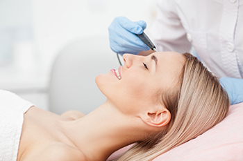 Woman About to Have Laser Skin Re-surfacing Performed on Her Face